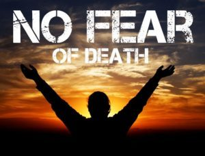 This image is the silhouette of a man holding his arms out at sunrise with the text No Fear of Death above him.