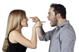 image of a angry couple pointing a finger at each other